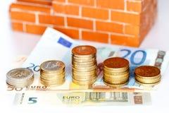 Cash money and bricks Stock Photography