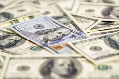 Cash money close up. one new and pile of old hundred dollar bil. Close up view of cash money. one new and pile of old bills hundred dollar bills Royalty Free Stock Images