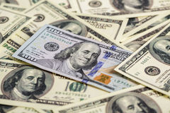 Cash money close up. one new and pile of old hundred dollar bil. Close up view of cash money. one new and pile of old bills hundred dollar bills Royalty Free Stock Image