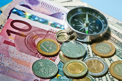 Cash money concept  compass Royalty Free Stock Photography