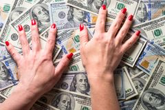 Conception of wealth and rich. Cash money dollar and woman hands. Conception of wealth and rich royalty free stock photo