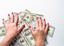 Conception of wealth and rich. Cash money dollar and woman hands. Conception of wealth and rich royalty free stock image