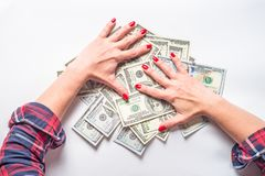 Conception of wealth and rich. Cash money dollar and woman hands. Conception of wealth and rich royalty free stock images