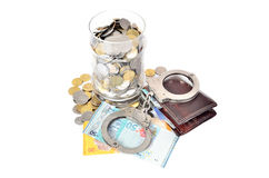 Cash money and handcuffs Royalty Free Stock Photography