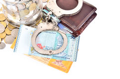 Cash money and handcuffs Royalty Free Stock Photos