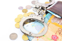 Cash money and handcuffs. The concept of crime and corruption stock images