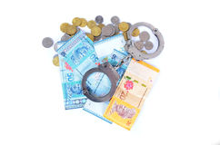 Cash money and handcuffs Stock Photography