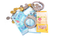 Cash money and handcuffs. The concept of crime and corruption Royalty Free Stock Photo