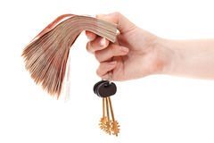 Cash money and house keys in hand. Cash Russian money and house keys are in caucasian hand isolated on white background Royalty Free Stock Photo