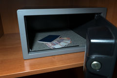 Cash Money Safe Deposit. Small Residential Vault with Cash Money and passport. Closeup Photo Royalty Free Stock Photo
