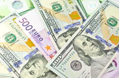 Cash money of USA and EU. Stack of euro and new dollar banknotes in soft focus Royalty Free Stock Photos