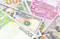 Cash money of USA and EU. Stack of euro and new dollar banknotes in soft focus Stock Photos