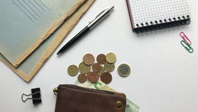 Cash with money on a white office desk stock footage