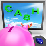 Cash On Monitor Shows Savings Stock Photo