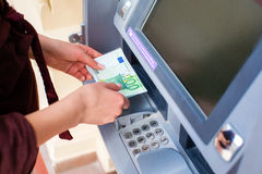 Cash out money at an ATM Stock Image