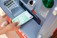 Cash out money at an ATM Stock Photos