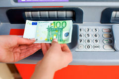 Cash out money at an ATM Royalty Free Stock Photos