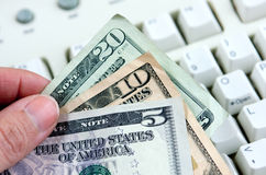Cash Over White Keyboard Royalty Free Stock Photography