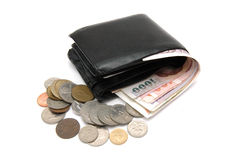 Cash overflowing from wallet Royalty Free Stock Photography