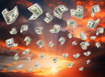 Cash, paper dollars, falling Royalty Free Stock Image