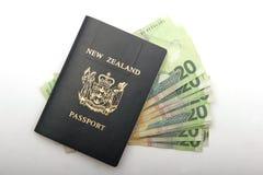 Cash in a passport. New Zealand passport with twenty dollar bills in it, to bribe customs maybe stock image