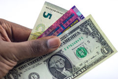 Cash and Passport in Hand Royalty Free Stock Photography
