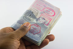 Cash and Passport in Hand Royalty Free Stock Photo