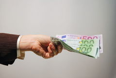 Cash payment Stock Images