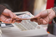 Cash payment moment. Detail of a woman's hand while she is paying in shop (Romanian money).Shot with Canon 70-200mm f/2.8L IS USM Stock Photos
