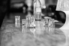 Cash payment. Ordering drinks in bar. Purchase and payment. Cash money concept. Leave tips for bartender. Tip given to. Waiter. Crumpled money cash at bar stock photography