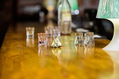 Cash payment. Ordering drinks in bar. Purchase and payment. Cash money concept. Leave tips for bartender. Tip given to. Waiter. Crumpled money cash at bar stock images