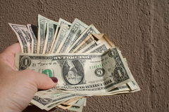 Cash Payout. Hand holding a stack of money Royalty Free Stock Images