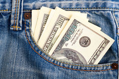 Cash in pocket of jeans. Royalty Free Stock Photo