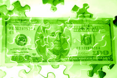 Cash & puzzle Stock Photo