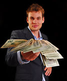 Cash rebate. Young professional in suit with twenty dollar bills Royalty Free Stock Photos