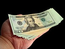 Cash Rebate. A hand holding a bunch of new 20 dollars United States currency royalty free stock images