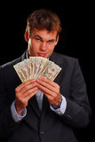 Cash rebate offer. Young professional in suit with twenty dollar bills Stock Image