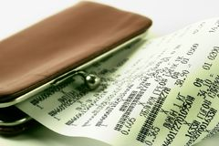 Cash receipt on background of a purse Royalty Free Stock Image
