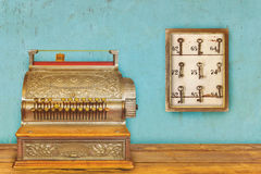 Cash register and cabinet with hotel keys and room numbers Royalty Free Stock Image