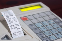 Cash register with cash register receipt Royalty Free Stock Photography