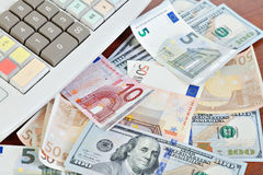 Cash register and different paper currencies Stock Image
