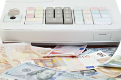 Cash register and different paper currencies Royalty Free Stock Image