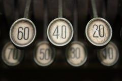Cash Register Keys. Closeup of an old cash register with dusty keys Stock Image