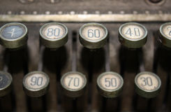 Cash Register Keys. Closeup of an old cash register with dusty keys Royalty Free Stock Images