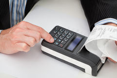 Cash register and receipt Royalty Free Stock Photography