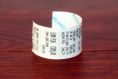 Cash register receipt. Polish cash register receipt on a wooden background royalty free stock photos