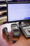 A cash register on wooden table Stock Photography