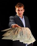 Cash return. Young professional in suit returning twenty dollar bills Stock Image