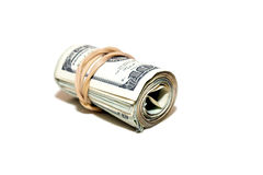 Cash roll. Roll of money wrapped with an elastic on a white background, angled awa Stock Photography