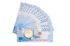 Cash rubles and electronic currency bitcoin. on white background royalty free stock photos
